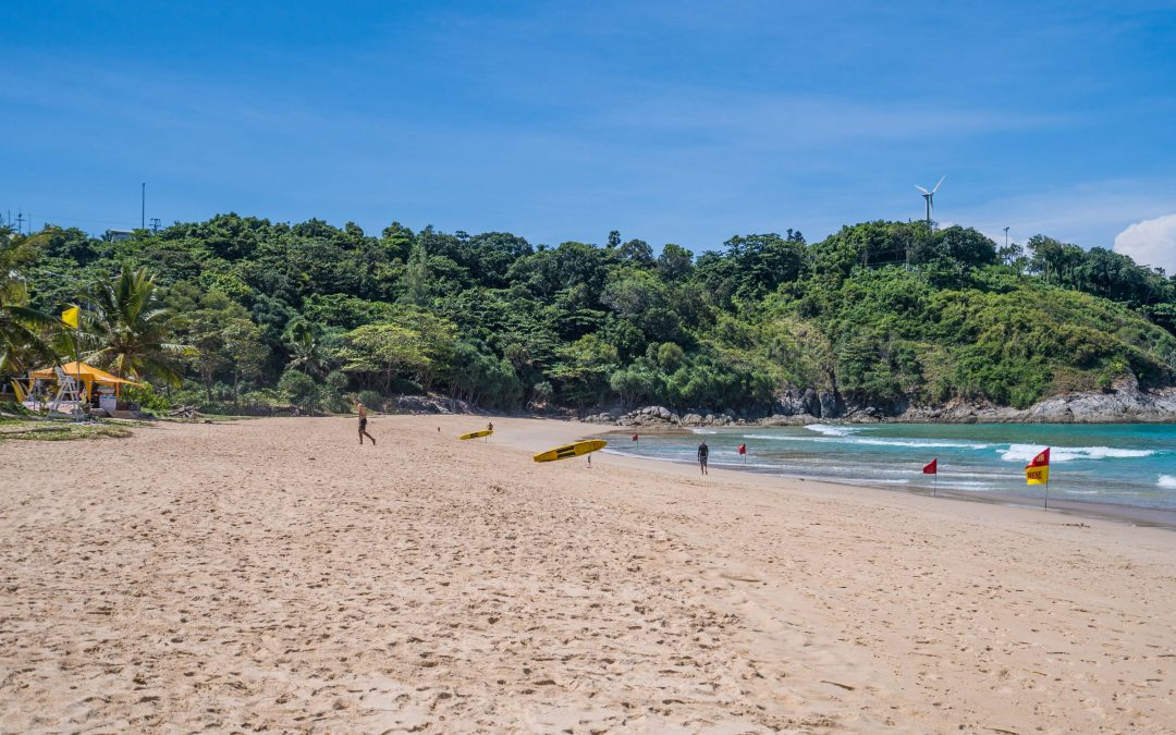 Why is Nai Harn Beach closed to the public when it gets dark?